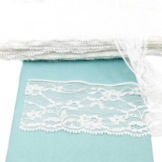 Puntilla de nylon blanca con encaje de ramilletes de flores y anchura 55 milímetros