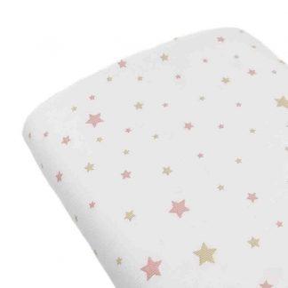 Tela piqué de canutillo con estampado de estrellas rosas y beige sobre fondo blanco