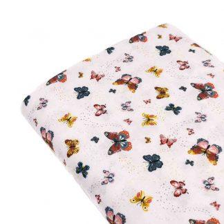 Tela popelín estampada con mariposas de colores en algodón orgánico certificado GOTS