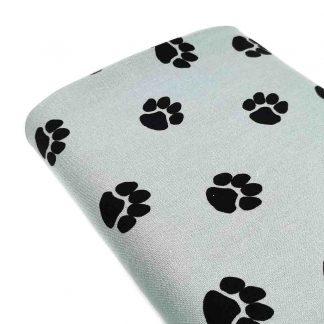 Tela de loneta de algodón estampada con huellas de perro negras sobre fondo color jade. Dog Paw Designed for you by POPPY Europe
