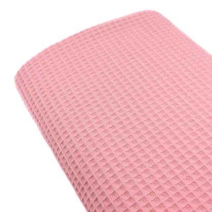Tela waffle de algodón 100% en color rosa chicle