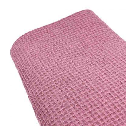 Tela waffle de algodón 100% en color rosa palo