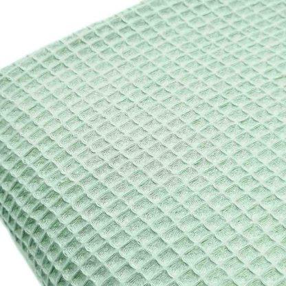 Tela waffle de algodón 100% en color verde agua