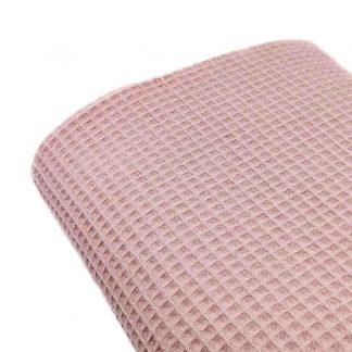 Tela waffle de algodón 100% en color rosa empolvado