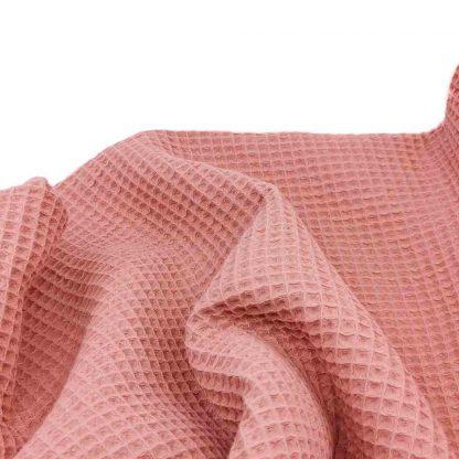 Tela waffle de algodón 100% en color salmón
