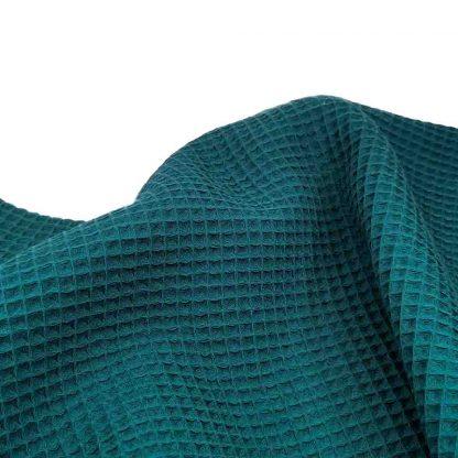 Tela waffle de algodón 100% en color verde marina