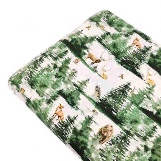 Tela popelín de algodón orgánico certificado GOTS con estampado de bosque nevado con animales salvajes