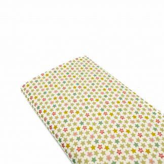 Tela de popelín de algodón orgánico certificado GOTS con estampado de estrellas y flores de colores