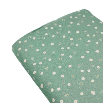 Tela de popelín de algodón orgánico estampado con florecitas sobre fondo verde agua