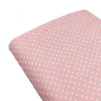 Tela piqué de canutillo con lunares de color blanco roto sobre fondo rosa bebé