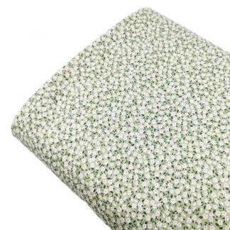Tela viyela de algodón orgánico GOTS con estampado de flores tipo liberty blancas sobre fondo verde jade