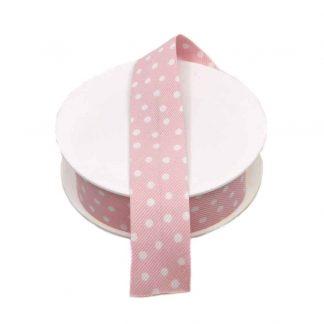 Cinta al biés de batista con estampado de lunares blancos sobre fondo rosa