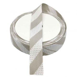 Cinta al biés de piqué con estampado de topos y rayas en color gris de 30 milímetros de ancho