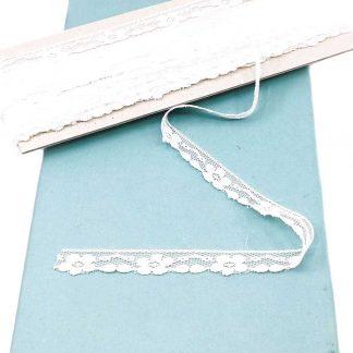 Puntilla de nylon blanca con encaje de margaritas y anchura 13 milímetros
