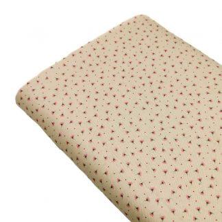 Tela viyela de algodón orgánico GOTS con estampado digital de flores en tonos rosa sobre fondo color vainilla