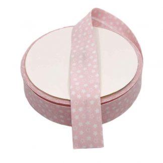 Cinta al biés de batista con estampado de estrellas blancas sobre fondo rosa bebé