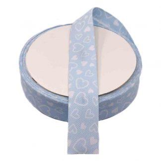 Cinta al biés de piqué con estampado de corazones en color azul celeste de 30 milímetros de ancho