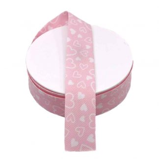 Cinta al biés de piqué con estampado de corazones en color rosa de 30 milímetros de ancho