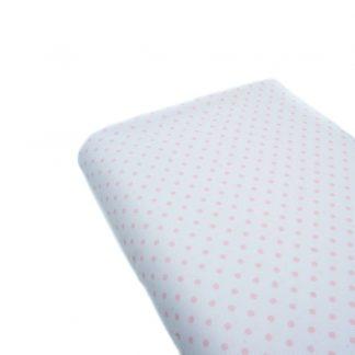 Tela de piqué de canutillo con estampado de lunares rosas sobre fondo blanco
