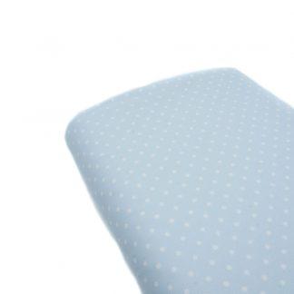 Tela de piqué de canutillo con estampado de lunares blancos sobre fondo azul