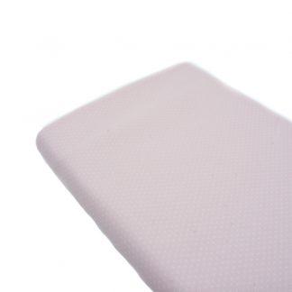 Tela de piqué de canutillo con estampado de lunares blancos de tamaño alfiler sobre fondo rosa