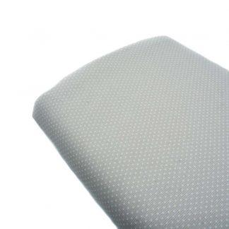 Tela de piqué de canutillo con estampado de lunares blancos de tamaño alfiler sobre fondo gris